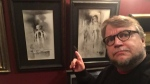 Producer Guillermo del Toro poses with original artwork from 'Scary Stories to Tell in the Dark'. (Twitter / Guillermo del Toro)
