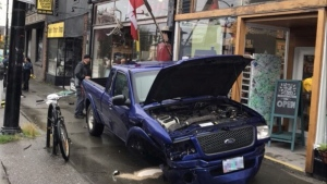 A damaged Ford Ranger pickup truck is seen in Vancouver's West Side on Sept. 15, 2018 in this photo taken by Allan Harding.