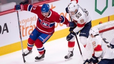 Montreal Canadiens' Max Domi tries to handle the puck away from Florida Panthers' Bogdan Kiselevich during first period NHL hockey action Wednesday, September 19, 2018 in Montreal. THE CANADIAN PRESS/Paul Chiasson