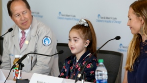 Heart transplant recipient Sofia Sanchez talks with reporters at Ann & Robert H. Lurie Children's Hospital Thursday, Sept. 20, 2018, in Chicago. (AP Photo/Teresa Crawford)
