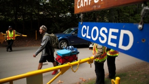A campground patron leaves Goldstream Campground as the provincial government assesses the situation with former Tent City residents who are living at the campground in Langford, B.C., on Thursday, September 20, 2018. (THE CANADIAN PRESS/Chad Hipolito)