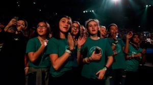 Members of the audience cheer during the We Day event in Toronto on Thursday, September 20, 2018. (THE CANADIAN PRESS/Christopher Katsarov)