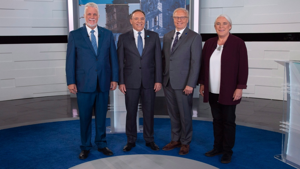 Liberal Leader Philippe Couillard, Coalition Avenir Quebec Leader Francois Legault, PQ Leader Jean-Francois Lisee and Quebec Solidaire Leader Manon Masse, left to right, stand on the television set for a photo prior to Face a Face Quebec 2018, the third Quebec elections leaders debate in Montreal, on Thursday, September 20, 2018. (THE CANADIAN PRESS/POOL/Sebastien St-Jean)