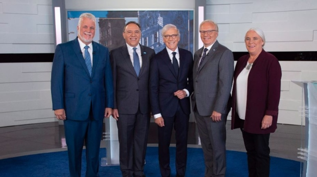 Liberal Leader Philippe Couillard, Coalition Avenir Quebec Leader Francois Legault, moderator Pierre Bruneau, PQ Leader Jean-Francois Lisee and Quebec Solidaire Leader Manon Masse, left to right, stans on the television set for a photo prior to Face a Face Quebec 2018, the third Quebec elections leaders debate in Montreal, on Thursday, September 20, 2018. THE CANADIAN PRESS/POOL/Sebastien St-Jean