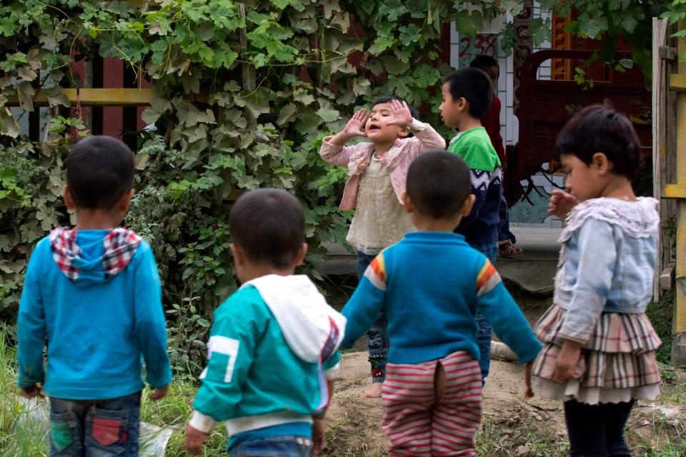 In this Aug. 30, 2018, photo, Uighur children play outdoors in Hotan, in western China's Xinjiang region. (AP Photo/Ng Han Guan)