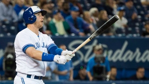 Toronto Blue Jays designated hitter Justin Smoak (14) watches as he hits the game winning walk off home run to defeat the Tampa Bay Rays during ninth inning AL baseball action in Toronto on Thursday, September 20, 2018. THE CANADIAN PRESS/Nathan Denette