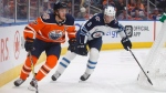 Winnipeg Jets' Jacob Trouba (8) chases Edmonton Oilers' Connor McDavid (97) during second period pre-season action in Edmonton, Alta., on Thursday September 20, 2018. THE CANADIAN PRESS/Jason Franson
