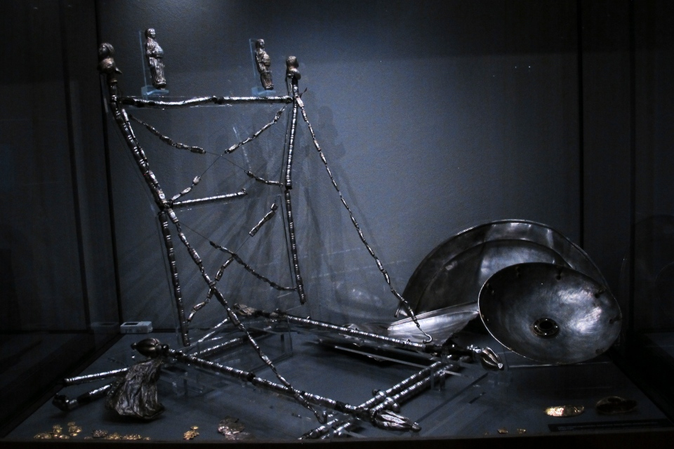 A woman's folding chair made from silver, dated to about 450 AD, displayed at the Martin-Gropius-Bau museum in Berlin, Thursday, Sept. 20, 2018. (AP Photo/Frank Jordans)