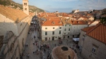 In this Sept. 7, 2018 photo, tourists walk through Dubrovnik old town. Crowds of tourist are clogging the entrances into the ancient walled city, a UNESCO World Heritage Site, as huge cruise ships unload thousands more daily. (AP Photo/Darko Bandic)