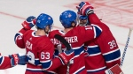 Montreal Canadiens' Brendan Gallagher, centre, and Matthew Peca, left, congratulate goalkeeper Charlie Lindgren after winning 5-2 against Washington Capitals in NHL exhibition game action on Thursday, September 20, 2018 in Quebec City. THE CANADIAN PRESS/Jacques Boissinot