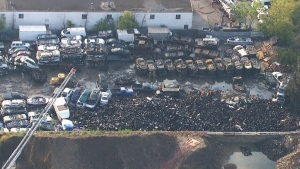 Crews battle intense Mississauga scrap yard fire