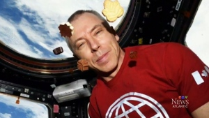 A Syrian family's chocolates have reached a new orbit, with astronauts on the International Space Station posing with chocolates in zero gravity,