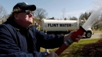 "This image released by State Run Films/Briarcliff Entertainment shows filmmaker Michael Moore in a scene from the documentary ""Fahrenheit 11/9."" (State Run Films/Briarcliff Entertainment via AP)"