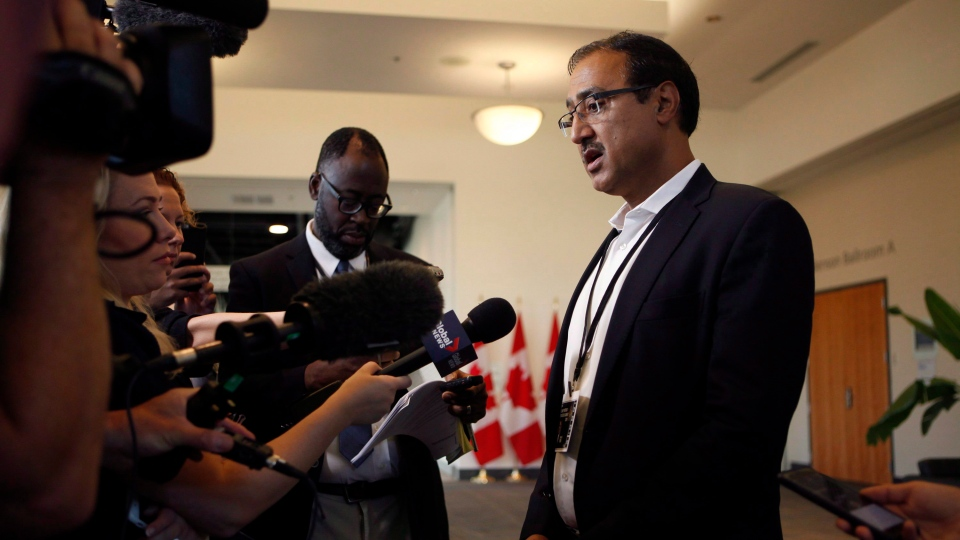Minister of Natural Resources Amarjeet Sohi stops to speak to the media at the Vancouver Island Conference Centre on the final day of meetings during the Liberal cabinet retreat in Nanaimo, B.C., on Thursday, August 23, 2018. THE CANADIAN PRESS/Chad Hipolito