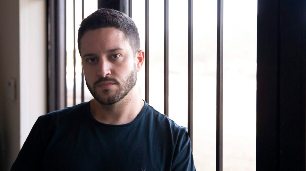 Cody Wilson poses for a portrait in the Defense Distributed office in Austin, Texas, on Tuesday, Aug. 7, 2018. (Lynda M. Gonzalez/Austin American-Statesman via AP)
