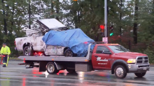 A pickup truck is carried away from the scene of a deadly crash on the Lougheed Highway in Burnaby.