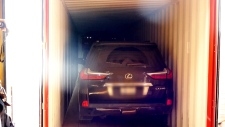 Luxury vehicle in shipping container