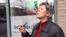 A woman smokes marijuana in Vancouver in this undated image.