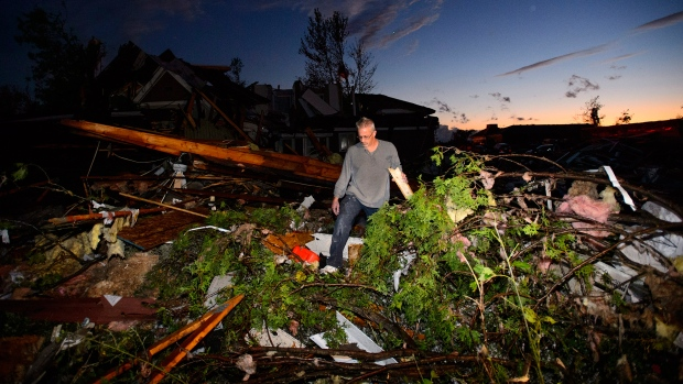 People collect personal effects from damaged homes following a tornado in Dunrobin, Ont. west of Ottawa on Friday, Sept. 21, 2018. (THE CANADIAN PRESS/Sean Kilpatrick)