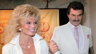 In this March 27, 1987 file photo, Burt Reynolds, right, holds hands with Loni Anderson at luncheon in Los Angeles. (AP Photo/Bob Galbraith, File)