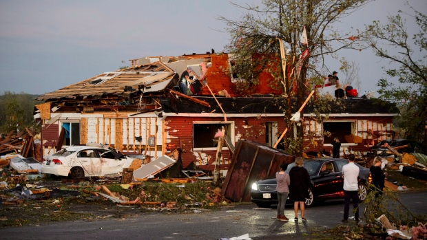 People collect personal effects from damaged homes following a tornado in Dunrobin, Ontario west of Ottawa on Friday, Sept. 21, 2018. (Sean Kilpatrick/The Canadian Press via AP)