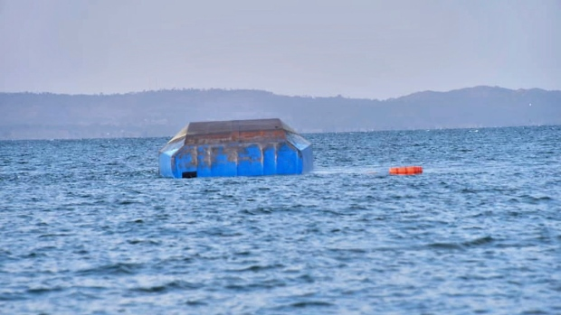 The upturned passenger ferry MV Nyerere floats in the water near Ukara Island in Lake Victoria, Tanzania Friday, Sept. 21, 2018. (AP Photo)