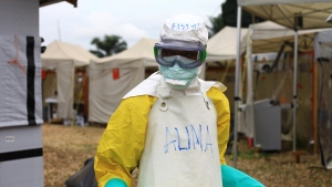 In this photo taken Sunday, Sept 9, 2018, a health worker in protective gear works at an Ebola treatment centre in Beni, Eastern Congo. (AP Photo/Al-hadji Kudra Maliro)