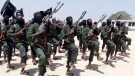 In this Thursday, Feb. 17, 2011 file photo, hundreds of newly trained al-Shabab fighters perform military exercises in the Lafofe area some 18 km. south of Mogadishu, in Somalia. (AP Photo/Farah Abdi Warsameh, File)