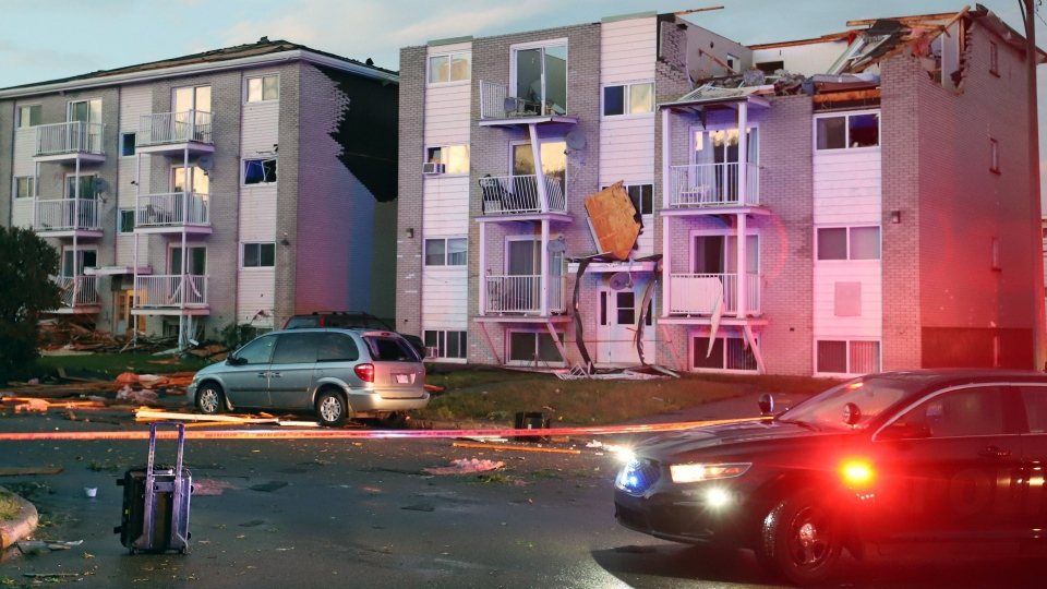 Apartment buildings are shown after a tornado torn roofs off and windows blown out after a tornado caused extensive damage to a Gatineau, Quebec neighbourhood forcing hundreds of families to evacuate their homes on September 21, 2018. THE CANADIAN PRESS/Fred Chartrand