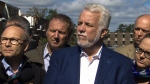 Quebec's political party leaders set their political differences aside on Saturday as they headed to Gatineau, Ont. to survey the damage from a tornado that ripped through homes and sent several people to hospital on Friday night.