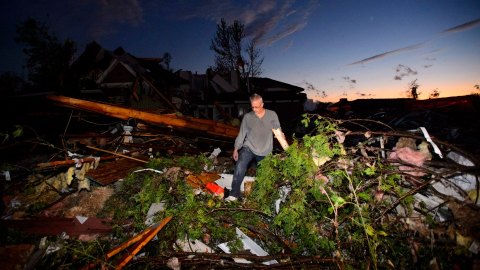 People collect personal effects from damaged homes following a tornado in Dunrobin, Ontario west of Ottawa on Friday, Sept. 21, 2018. (THE CANADIAN PRESS/Sean Kilpatrick)