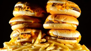 File photo of a pile of cheeseburgers and french fries. (PA Photos Limited 2001 all rights reserved)