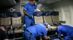 In this Sept. 23, 2013 photo, Southwest Airlines aircraft technicians install newer, skinnier seats on a 737 at the carrier's headquarters in Dallas. (AP Photo/John Mone)