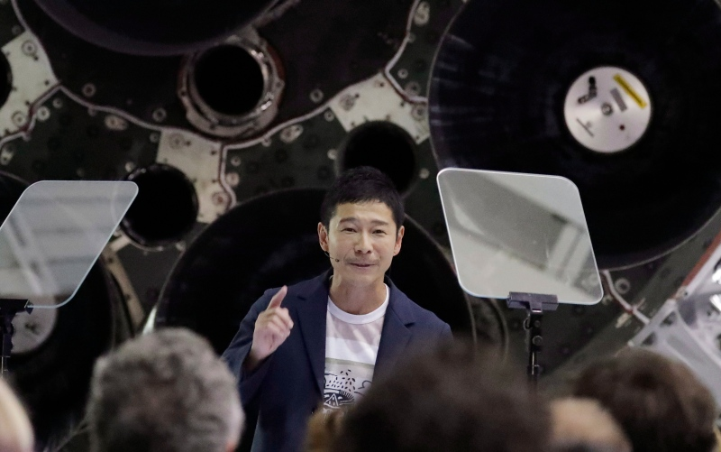 Japanese billionaire Yusaku Maezawa speaks after SpaceX founder and chief executive Elon Musk announced him as the person scheduled to be the first private passenger on a trip around the moon, Monday, Sept. 17, 2018, in Hawthorne, Calif. (AP Photo/Chris Carlson)