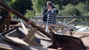 Christine Earle, right, leans on the shoulder of her friend Gillian Szollos as they look at the damage caused by a tornado at her farm in Dunrobin, Ont., west of Ottawa, on Saturday, Sept. 22, 2018. THE CANADIAN PRESS/Justin Tang
