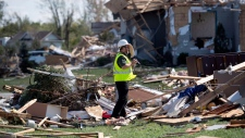 Dr. David Sills, a severe weather scientist for Environment Canada, takes photos to help determine the category of a tornado in Dunrobin, Ont., west of Ottawa, on Saturday, Sept. 22, 2018. The storm tore roofs off of homes, overturned cars and felled power lines in the Ottawa community of Dunrobin and in Gatineau, Que. THE CANADIAN PRESS/Justin Tang
