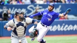 Toronto Blue Jays Kevin Pillar comes in to score a run as Tampa Bay Rays catcher Jesus Sucre bobbles the ball during fourth inning American League baseball action in Toronto, Saturday, Sept. 22, 2018. THE CANADIAN PRESS/Frank Gunn