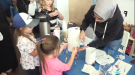 Girls gets a lesson in science, technology, engineering and math at STEMCOM. (Sept. 22, 2018)