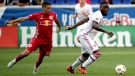 Toronto FC forward Jozy Altidore, left, tries to control the ball as New York Red Bulls defender Tim Parker, center, and defender Michael Murillo apply pressure during the first half of a soccer game, Saturday, Sept. 22, 2018, in Harrison, N.J. (AP Photo/Julio Cortez)