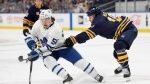 Toronto Maple Leafs left wing Emerson Clark, left, is defended by Buffalo Sabres defenseman Jake McCabe during the first period of an NHL preseason hockey game in Buffalo, N.Y., Saturday, Sept. 22, 2018. (AP Photo/Adrian Kraus)