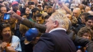 Ontario Premier Doug Ford poses for a selfie with a supporter after speaking at Ford Fest in Vaughan, Ontario, on Saturday September 22, 2018. Event organizers say the annual barbecue is expected to be bigger than ever with Doug Ford as premier. (THE CANADIAN PRESS / Chris Young)