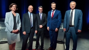 NDP Jennifer McKenzie, left to right, Green Party David Coon, People's Alliance Kris Austin, Liberal Brian Gallant, PC Blain Higgs pose for photos before the start of the New Brunswick leaders debate in Riverview, New Brunswick on Wednesday September 12, 2018. (THE CANADIAN PRESS / Marc Grandmaison)