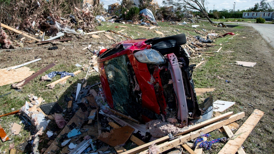 A car destroyed by a tornado is seen in Dunrobin, Ont., west of Ottawa, on Saturday, Sept. 22, 2018. The storm tore roofs off of homes, overturned cars and felled power lines in the Ottawa community of Dunrobin and in Gatineau, Que. (THE CANADIAN PRESS / Justin Tang)