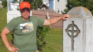 "Gemma Hickey is shown at the Mount Cashel Memorial, August 2, 2015, after walking 30 days straight across Newfoundland to raise awareness and funds for an organization for survivors of religious institutional abuse. Hickey has written a letter to Pope Francis, saying the Vatican ""owes God an apology"" for the mismanagement of abuse allegations. (THE CANADIAN PRESS / HO-Gemma Hickey)"