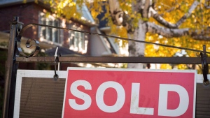 A real estate sold sign hangs in front of a west-end Toronto property Friday, Nov. 4, 2016. The Toronto Real Estate Board will make a password-protected feed with the numbers available to realtors by Sept. 18. THE CANADIAN PRESS/Graeme Roy