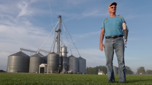 "Jack Maloney poses in front of the grain bins on his Little Ireland Farms in Brownsburg, Ind., Wednesday, Sept. 12, 2018. Maloney, who farms about 2,000 acres in Hendricks Count, said the aid for farmers is ""a nice gesture"" but what farmers really want is free trade, not government handouts. American farmers will soon begin getting checks from the government as part of a billion-dollar bailout to help those experiencing financial strain from President Donald Trump's trade disputes with China(AP Photo/Michael Conroy)"
