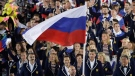 Sergei Tetiukhin carries the flag of Russia during the opening ceremony for the 2016 Summer Olympics in Rio de Janeiro, Brazil, on Aug. 5, 2016. T (AP / Matt Slocum, File)
