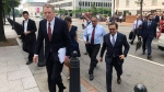 "United States Trade Representative Robert Lighthizer, front left, and Mexican Secretary of Economy Idelfonso Guajardo, front right, walk to the White House on Monday August 27, 2018. President Donald Trump says the prospects are ""looking good"" for an agreement with Mexico that could set the stage for an overhaul of the North American Free Trade Agreement. (AP / Luis Alonso Lugo)"