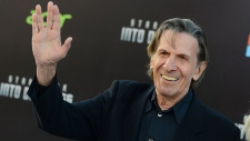 """In this May 14, 2013 file photo, Leonard Nimoy arrives at the LA premiere of """"Star Trek Into Darkness"""" at The Dolby Theater in Los Angeles. The death of actor Nimoy on Feb. 27, 2015, has inspired people to post photos on social media of marked-up five-dollar Canadian banknotes that show former prime minister Wilfrid Laurier transformed to resemble Spock, Nimoy's famous """"Star Trek"""" character. For years, Canadians have been wielding pens to draw Spock's pointy Vulcan ears, sharp eyebrows and signature bowl haircut on the fiver's image of Laurier, Canada's first french prime minister. (Photo by Jordan Strauss/Invision/AP, File)"""