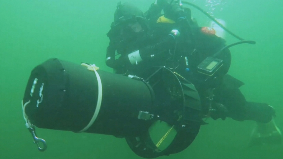 Diver Nathalie Lasselin with her video equipment